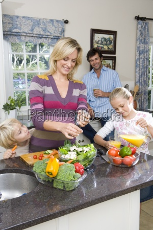 mother making salad by daughter 8