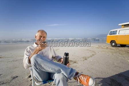 senior man in chair on beach