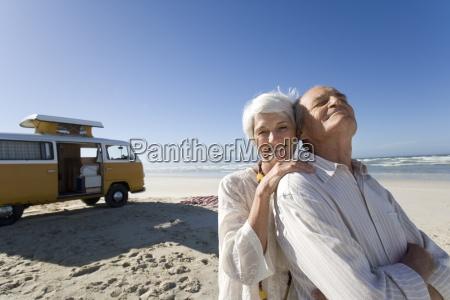senior woman embracing senior man from