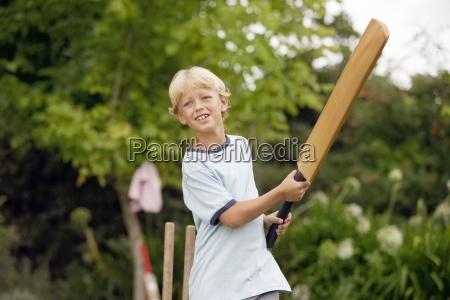 blonde boy 8 10 playing cricket