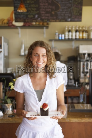 waitress working behind counter in cafe