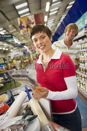 couple shopping in diy store woman