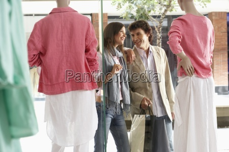 couple, walking, past, window, display, in - 12962854