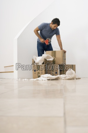 man moving house using duct tape