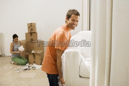 couple moving house man lifting white