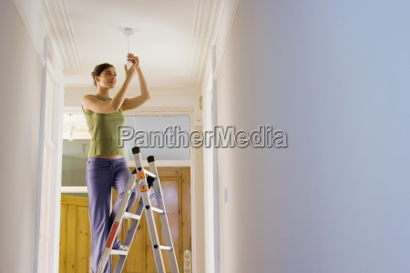 woman doing diy at home standing