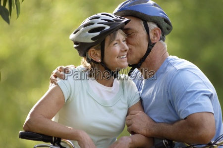 active senior couple in cycling helmets