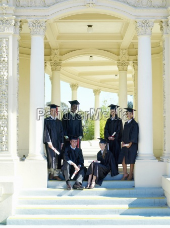 young people graduating in cap and