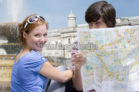 couple, sightseeing, with, map - 12963854
