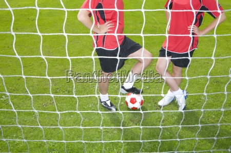 soccer players with ball standing at