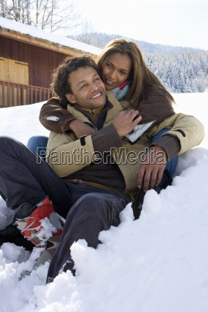 mixed race couple hugging in winter