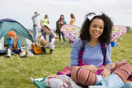 teenage girl in fairy costume camping