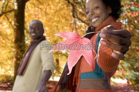 african woman holding red autumn
