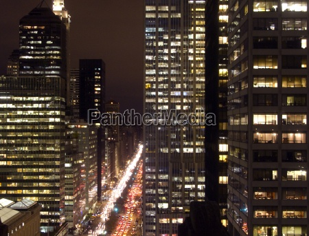 urban cityscape with cars and highrises