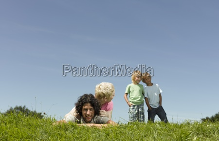 a family outdoors in summertime