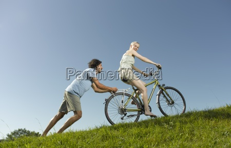 a woman on a bicycle man