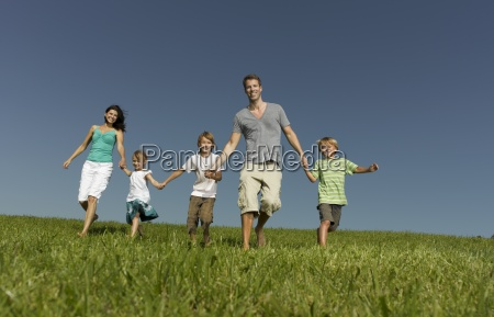 a family of five walking hand