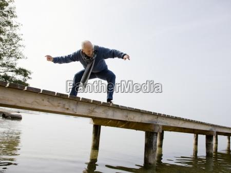 a senior man standing on a