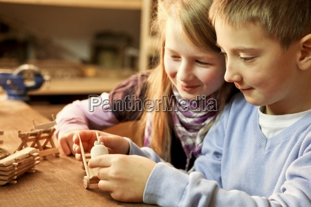 young boy and girl making wooden