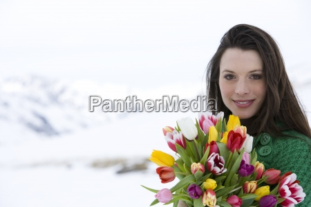 portrait of young woman holding bouquet