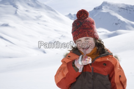 portrait of young girl eating icicle
