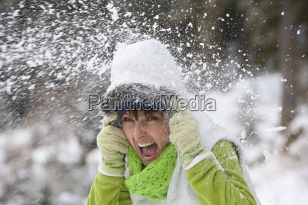 shouting woman getting hit with snowball