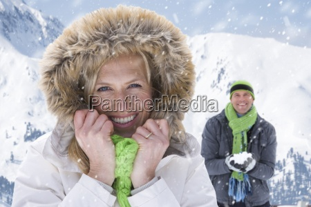 smiling woman in fur hood with