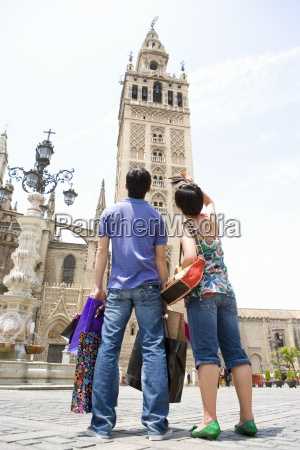 couple with shopping bags sight seeing