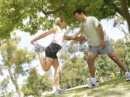 young couple stretching in preparation for