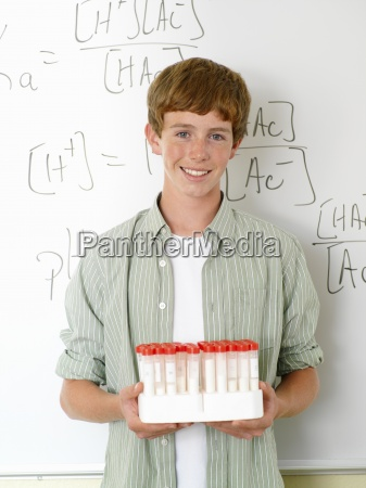 boy 10 12 with chemistry samples