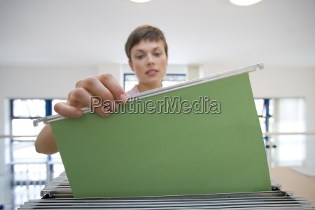 businesswoman selecting file
