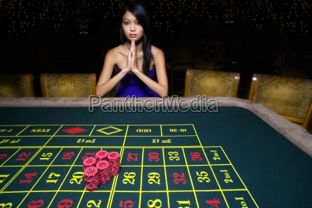 woman gambling at roulette table