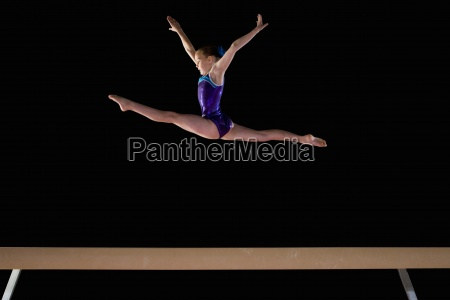 young female gymnast 9 11 performing