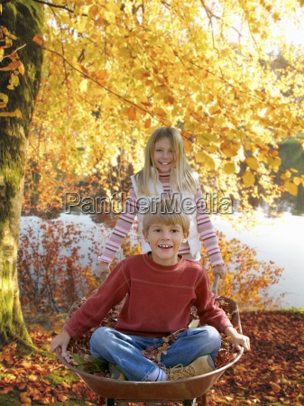 brother and sister with wheelbarrow on