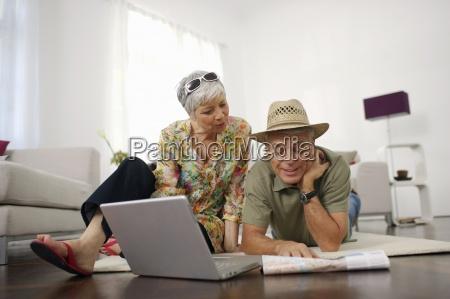 senior couple at home looking at