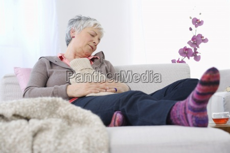 senior woman resting at home with