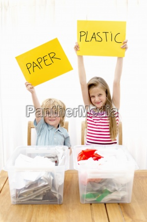 boy and girl holding paper and