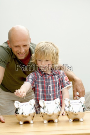 father and son putting coin in