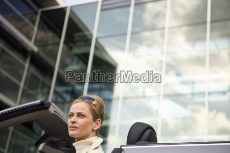 mature adult woman sitting in convertible