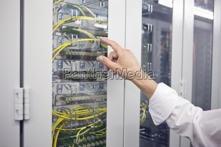 detail of computer server with hand