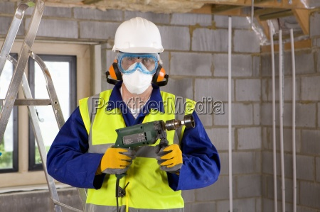 man wearing protective clothing and holding