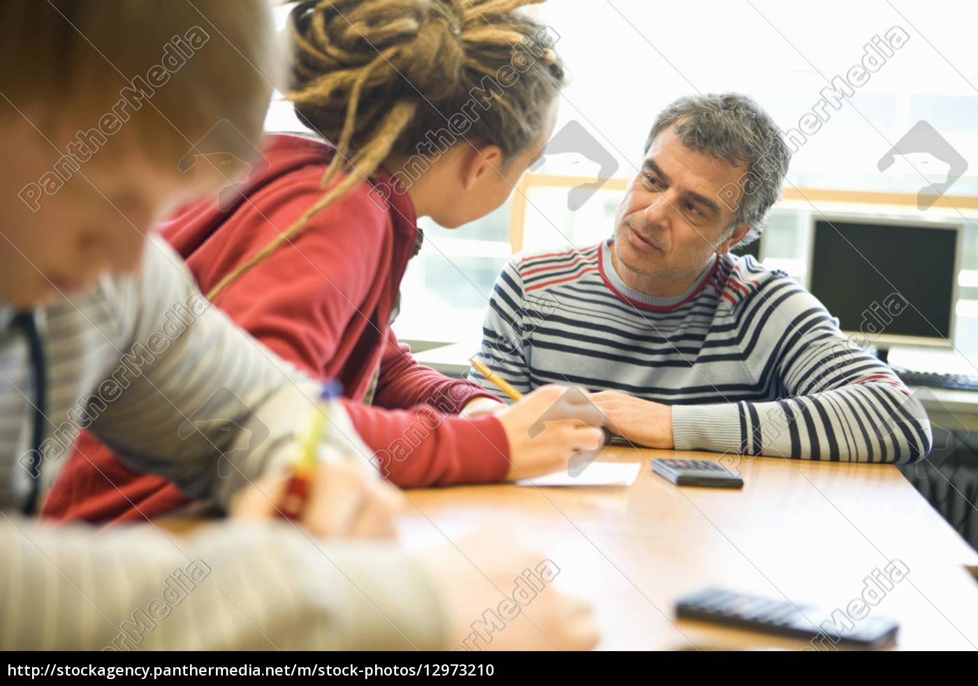 teenage, student, getting, help, from, teacher - 12973210