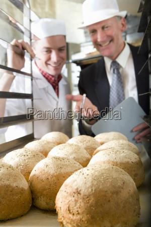 inspector talking to baker in bakery