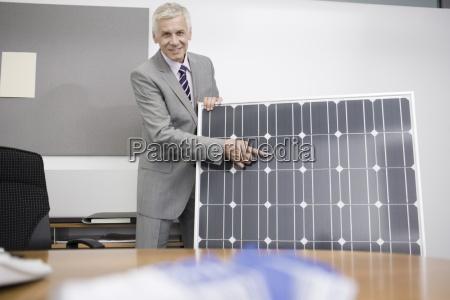 a mature businessman in an office