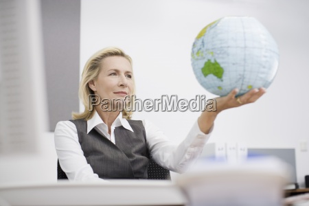 a businesswoman in an office holding