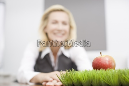 a businesswoman in her office looking
