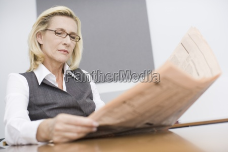 a mature businesswoman in her office