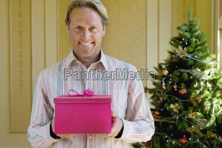 mature man with pink gift box
