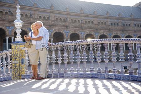 senior couple on bridge looking at