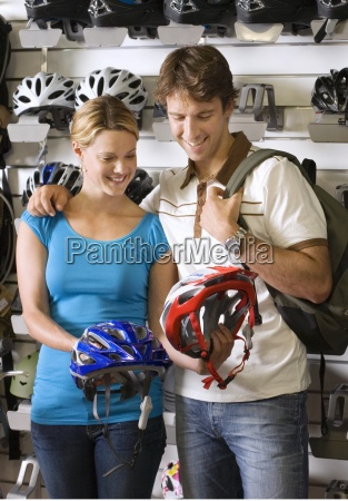 young couple shopping for new cycling